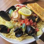 """Concrete Jungle"" scallops, mussels, grilled veggies, fettuccine and more,"