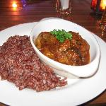 Bademjam: Stewed eggplant with chicken and red rice
