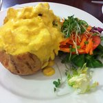 coronation chicken on jacket potatoe with side salad