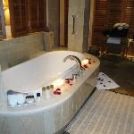 bathroom with petals and candles lit on arrival in suite