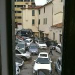 """The hotel's parking courtyard as seen from our room in """"the annex""""."""