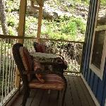 covered upper deck of Treehouse #5. The cliff is beautiful!