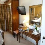 Wardrobe, TV and dressing table in room