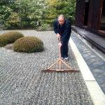 Rev. Taka Kawakami raking the Zen garden