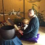 Rev. Taka Kawakami performing a Zen ritual