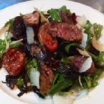 pepper seared beef fillet with balsamic onions, slow roasted tomatoes, rocket & pecorino cheese