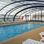 swimming pool with removable roof