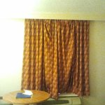 Droopy and depressing curtains that don't go all the way across wall