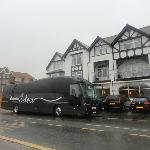 The coach parked outside the hotel