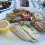 Seafood platter with tuna, sea bream, swordfish, octopus, prawns and mussels