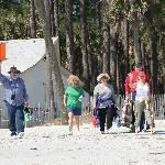 Happy People Walking Onto Hunting Island Beach