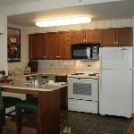 Convenient eating area and full kitchen