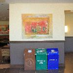 Art and trash cans in the restaurant area.