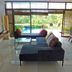 Bumi 2 living/dining/kitchen with deck and pool in background