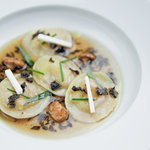 Foie gras ravioli, delicate duck consomme, fresh herbs
