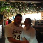 under the mushroom in rainforest cafe Anaheim CA December 2011 me and the wife