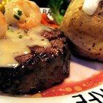 Steak with prawns close up