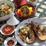 Salads & grilled for lunch on the rooftop: lobster, keftas...