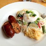 breakfast 2nd course- perfectly poached egg w/creamy vegetable polenta & chicken sausage