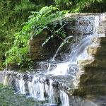 Flowing waterfall graces the side yard