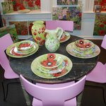 Eclectic Farm Table with Modern Italian Pink Chairs and Hand-painted pottery
