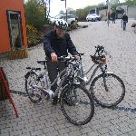 Renting electric bicycles in front of reception