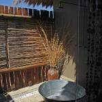Private outdoor shower area off our bathroom