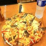 veggie pizza has yellow pumpkin, tastes sweet, but good