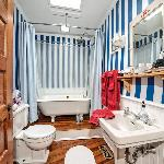 Annapolis Room detacted bathroom with rainshower clawfoot tub