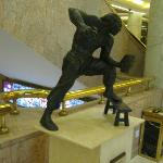 One of the statues in the foyer, a martial art using a stool.
