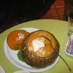 Delicious pumpkin stuffed with lobster and coconut sauce