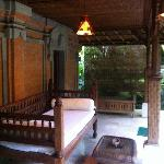 Verandah outside room with daybed and table