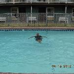 Husband swimming in heated pool