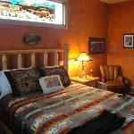 Grand Canyon room,  bed and the stained glass in the window