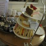 Afternoon Tea: cream pie, a scone with clotted cream, an Empire biscuit and sandwiches (£9.95)