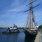 Tugboat and a tall ship.