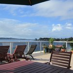 Deck overlooking the bay - perfect for enjoying breakfast and sunset drinks.