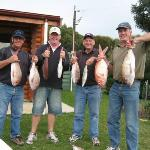 Happy visitors displaying their catch