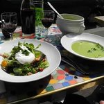 A typical salad with poached egg and potato and asperagus soup