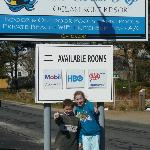 In front of the hotel sign...2 thumbs up