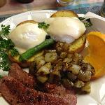Poached eggs, reindeer sausage, asparagus, potatoes with mushrooms and a slice of orange, BOOM!