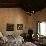 Room 4 interior.  Fireplace in corner.