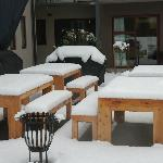 Outside tables covered with snow