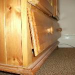 Broken, damaged and dusty wardrobe drawer.
