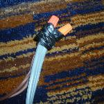 The splice that runs under bed for power to bed room