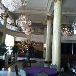 Chandeliers, marble columns on Main floor, view of check in