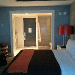 Standing in room towards door