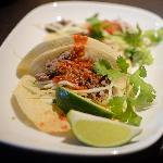Pork carnitas in our house-made soft tacos