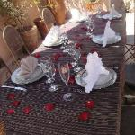Table set with rose petals by pool for lunch