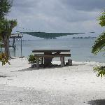 Shaded beach side table with view of cays